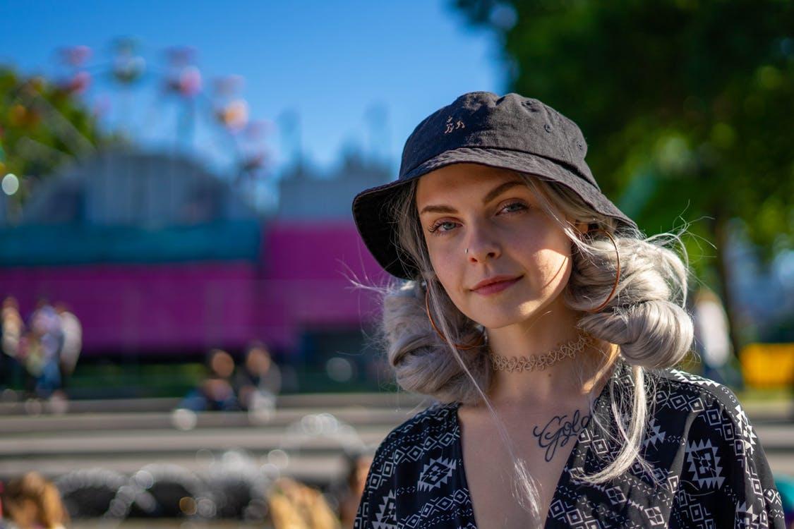 Close-Up Photo of Woman Wearing Bucket Hat