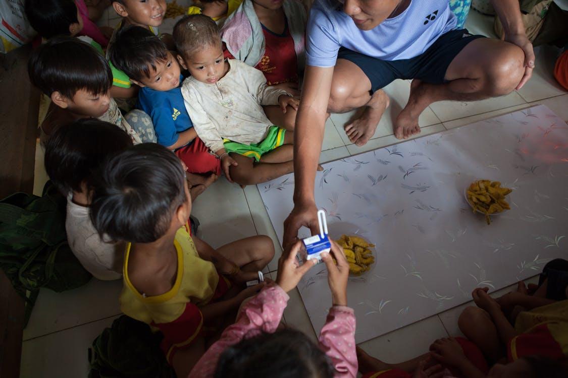 Children Playing on Floor Tiles