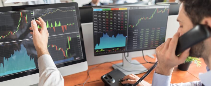 How do currency fluctuations impact the stock price of companies?